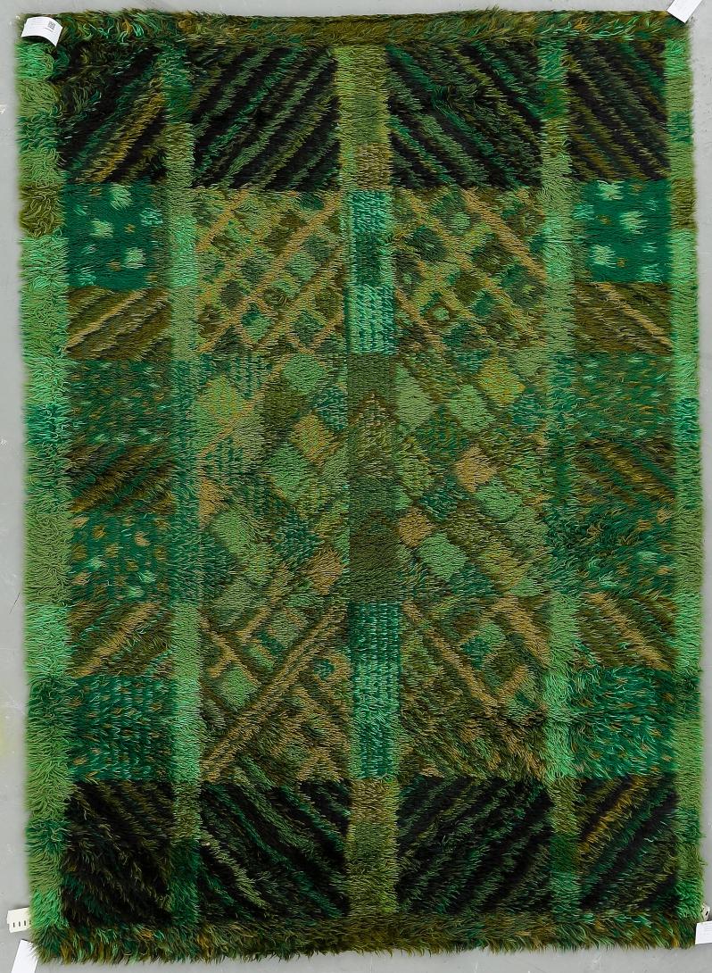 """70""""Bjälbo"""", Marianne Richter, AB Wahlbecks fabriker, 1960 70-tal. Ca 196x140 cm. Geometrisk dekor i gröna och bruna nyanser. Formgiven omkring 1969. Etikettmärkt. Buk 3-17-15"""