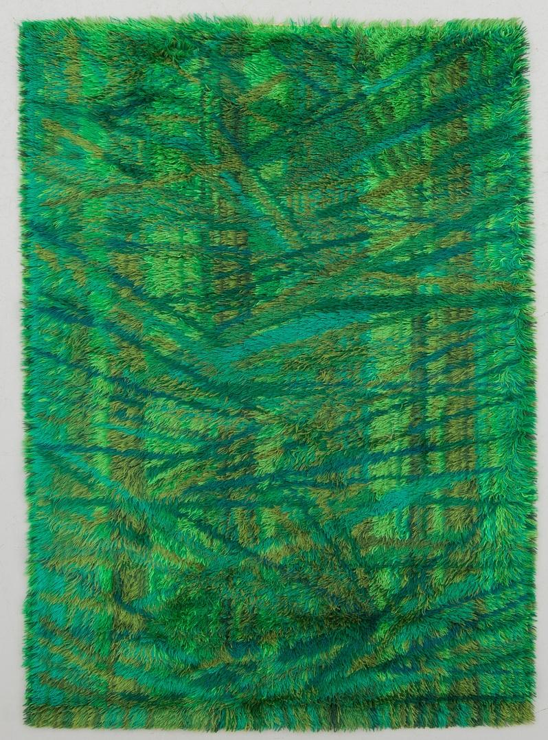 """89 """"Sommarhage"""", Marianne Richter. Wahlbecks Fabriker, Linköping. Ca 200 x137 cm. Mönster i övervägande gröna nyanser. Etikettmärkt.Buk 11 1714"""