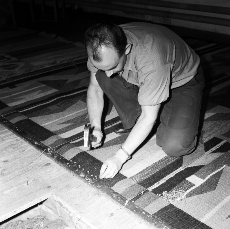 17. 1950s Bengt Jonsson getting ready to nail rug